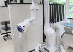 口腔外バキュームにより、治療時の粉じんを吸収していきます