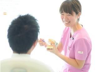 診療風景です。笑顔を大切にしております。