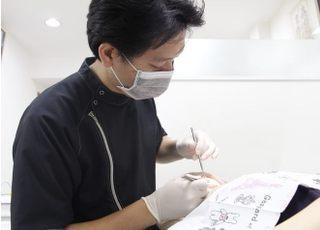 吉田歯科医院_先生の専門性・人柄2